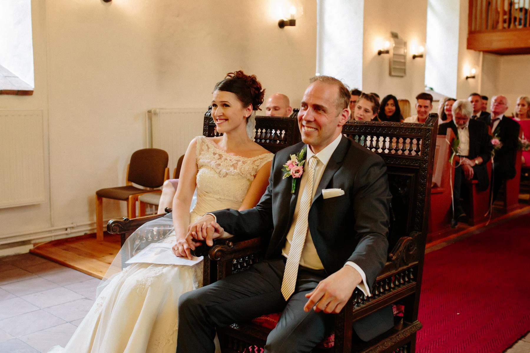 wedding couple sitting in the old village church in Berlin Lankwitz